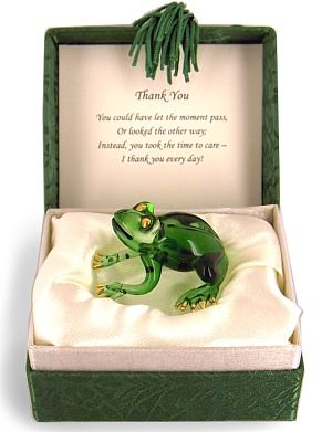 "Thank-You Green Frog Messenger.  Send this elegant keepsake frog with his heartfelt message to someone special. When you open the tasseled green satin-lined box, on the inside of the lid it says:   Thank You You could have let the moment pass, Or looked the other way, Instead, you took the time to care - I thank you every day!  The little green glass frog has gold toes and eyes, and is sure to be a valued treasure. Size: Box is 2"" x 3"" x 3-1/2"", green glass frog is about 2"" long. US $15.95"