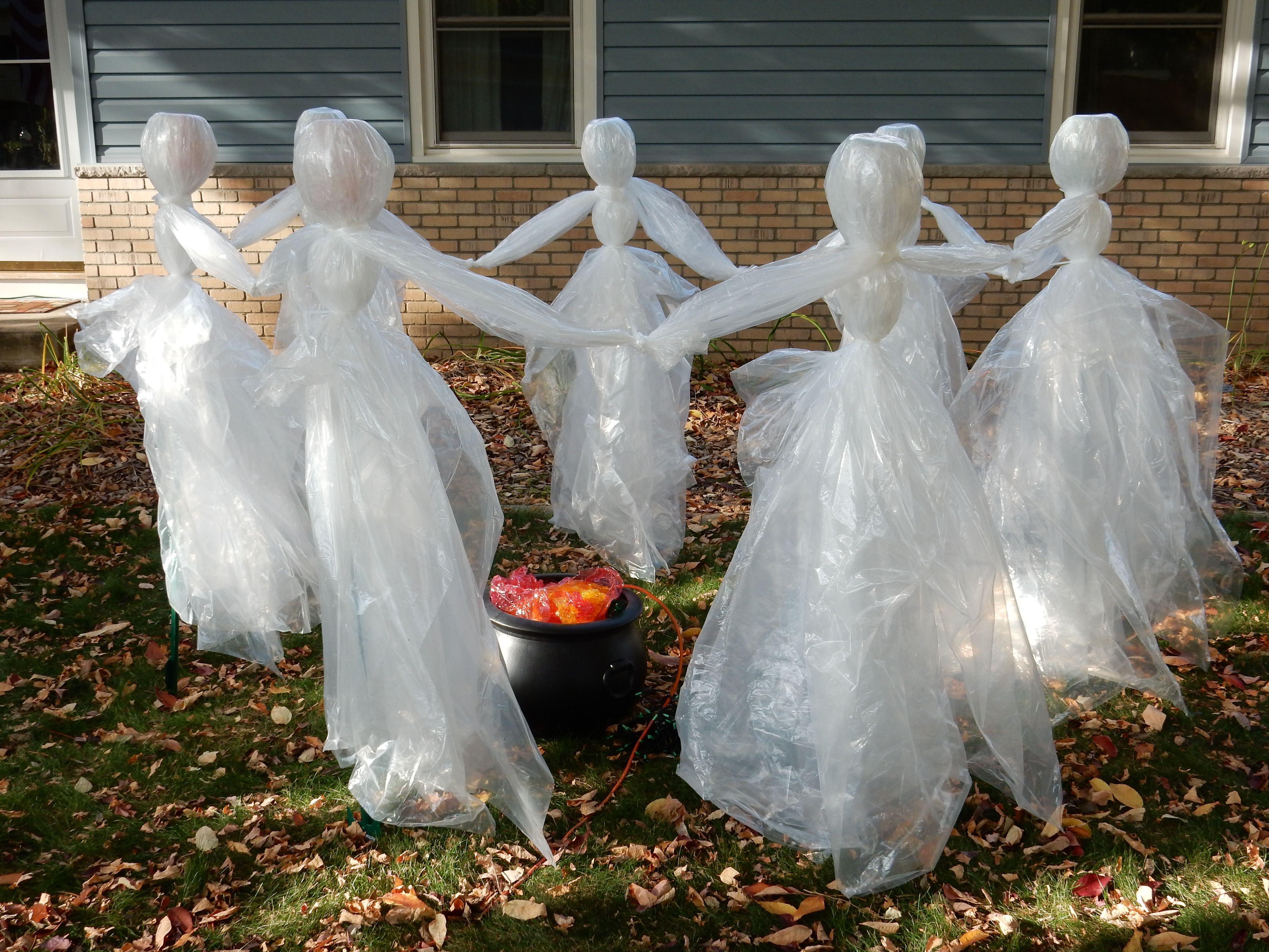 Halloween 2014 Build -- Ghost Dancers. Seven 5 ft fence posts, 10x10 plastic drop cloths, bubble wrap, zip ties. Less than $6 each, less than 1 hr to assemble.