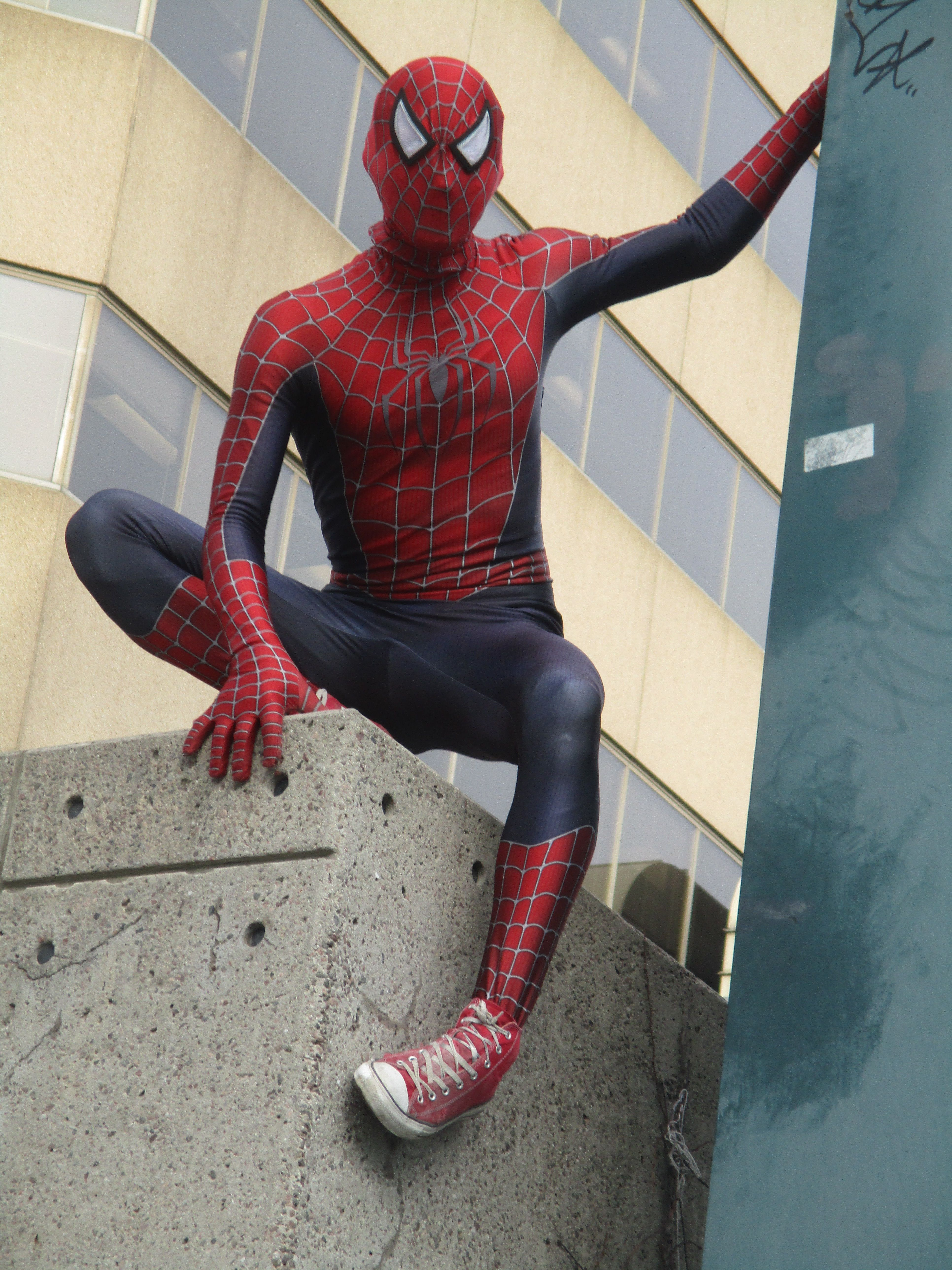 10b59209a3c Spiderman is a fan of red Converse hi-tops