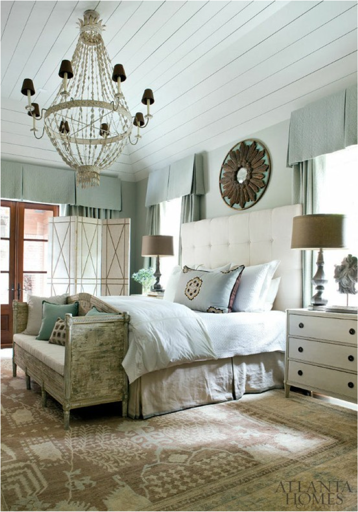 This romantic bedroom decor includes a chandelier