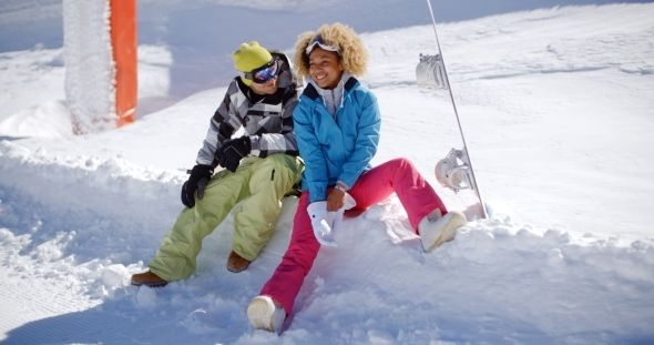 Download Free              Happy Young Couple Relaxing On a Snow Shelf               (Stock Footage)            #               afro #beautiful #couple #friends #girl #holidays #man #mountains #resort #ski #snowboard #sporty #talking #winter #woman