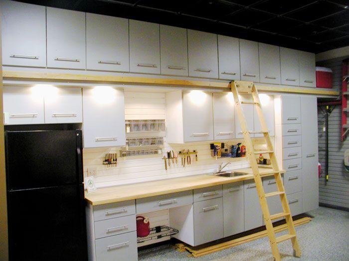 Custom garage storage cabinets and slat wall storage for Custom garage workshop