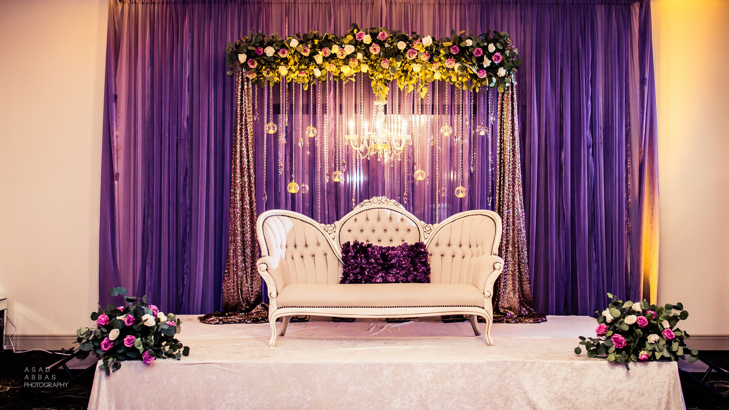 Lilac engagement stage draped backdrop with fresh floral for Background decoration
