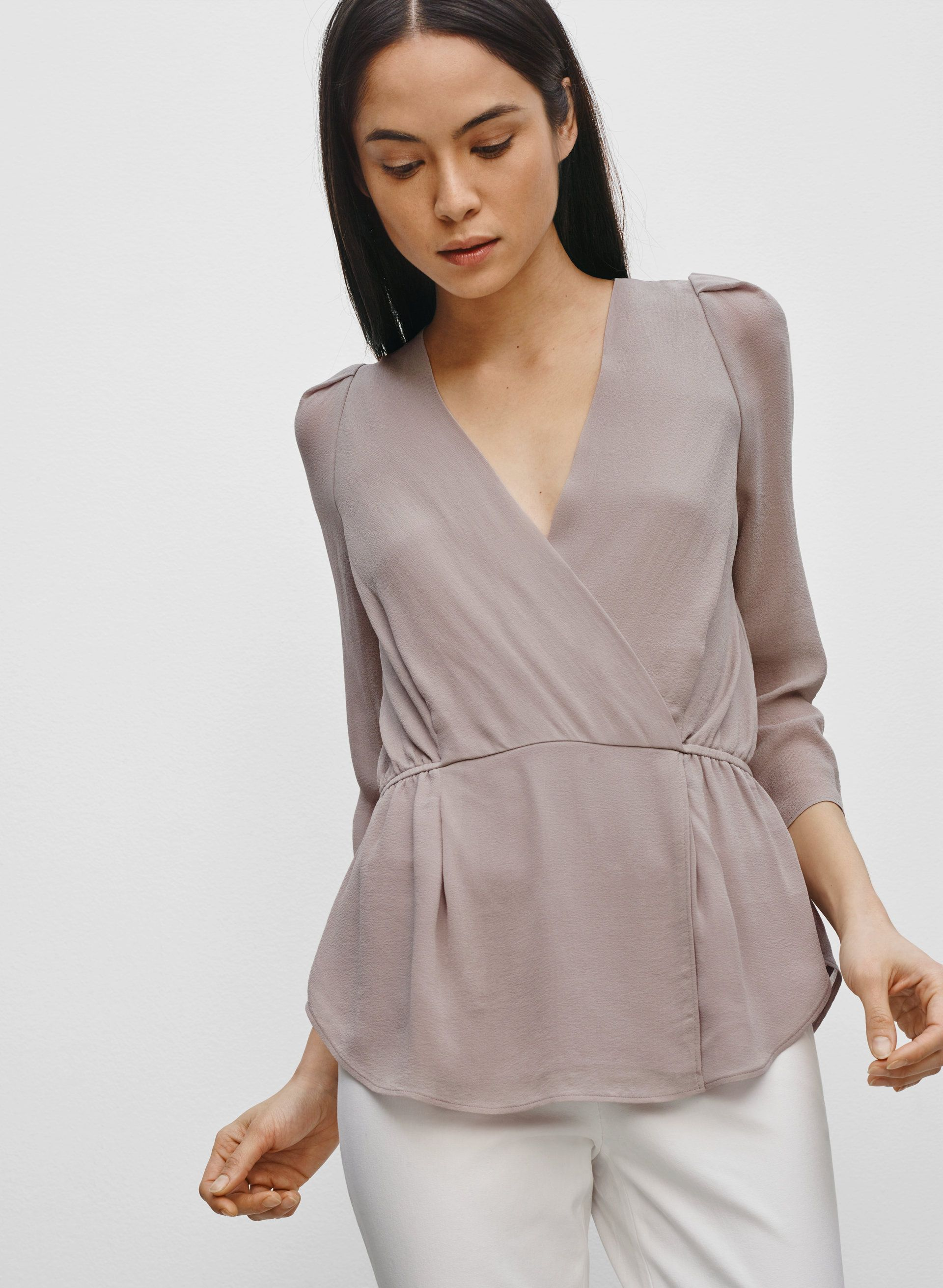89df10cbfdfd93 Babaton ALEXANDER BLOUSE, $115, A toned-down peplum with minimalist  sophistication | Aritzia