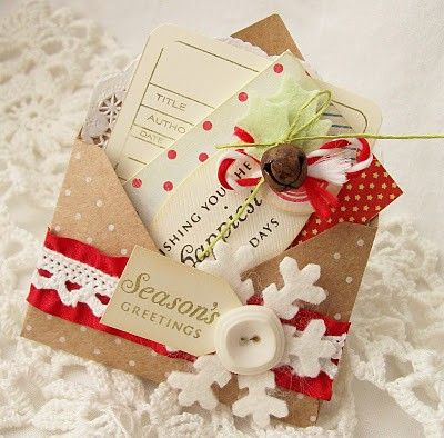 This handmade Christmas card is a gorgeous Christmas paper craft filled with wintry embellishments!