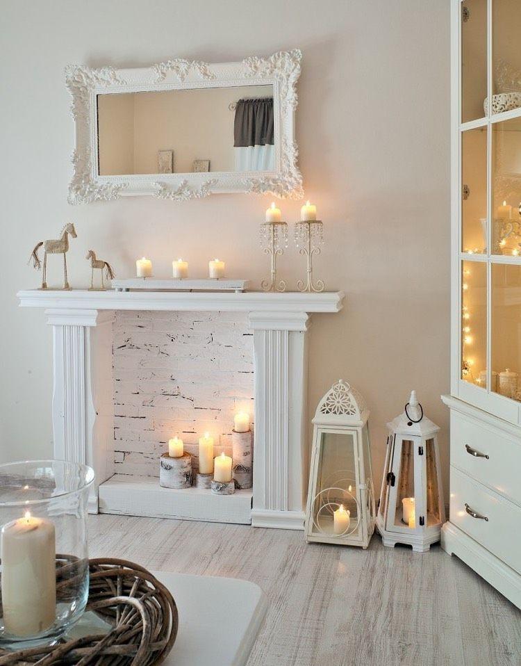 Deko wohnzimmer kerzen  Kerzen auf unterschiedlich hohen Birkenholzstämmen | Shabby chic ...