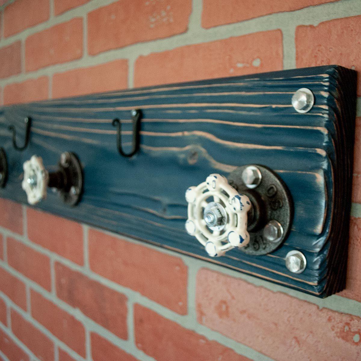 Aged wood modern farmhouse coat hanger with iron key