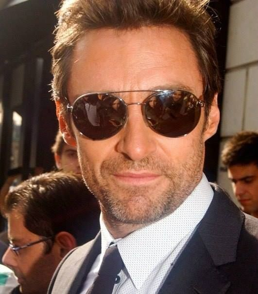 Hugh in my fantasies is a secret service agent and the sexiest one to work for the president.Or maybe just a sexy private eye and this is the only way he looks and travels in public.