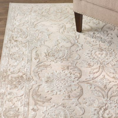 This Anna Ivory Area Rug, Brimming With Soft Hues And Feminine Details.  This Bold