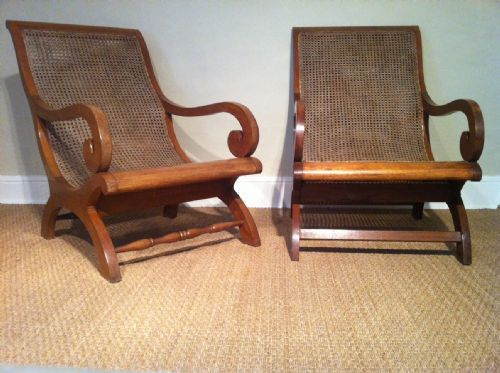 Charming A Matched Pair Of Colonial Teak And Caned Plantation Chairs C 1920