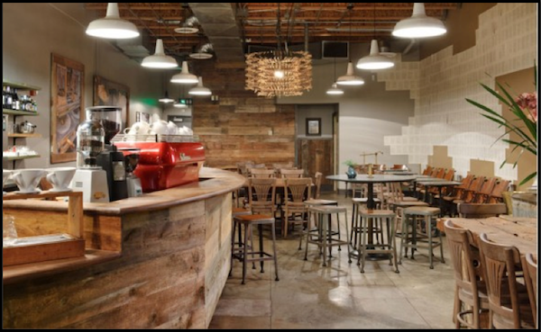 Sustainable Barn Lighting In A Rustic Starbucks Coffee Shop Coffee Shop Interior Design Coffee Shops Interior Cozy Coffee Shop