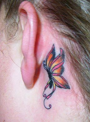 would like to cover my ugly rose tattoo (it's at the top of my hip bone) with a butterfly and flowers