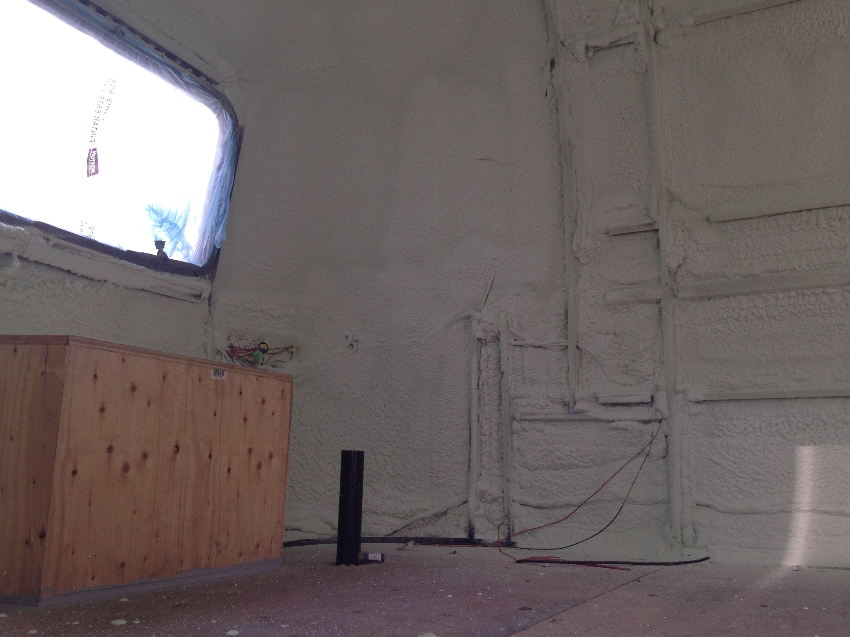 Spray foam insulation in an Airstream trailer. http