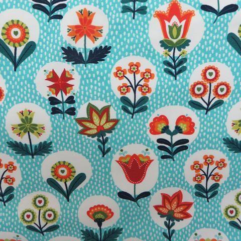 Blumenmuster auf türkisem Grund