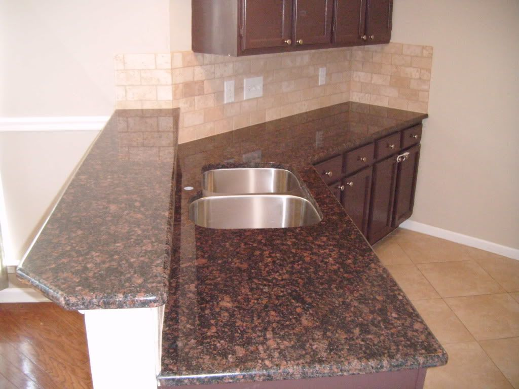 Tan brown granite countertops with subway tile backsplash Tan kitchen backsplash