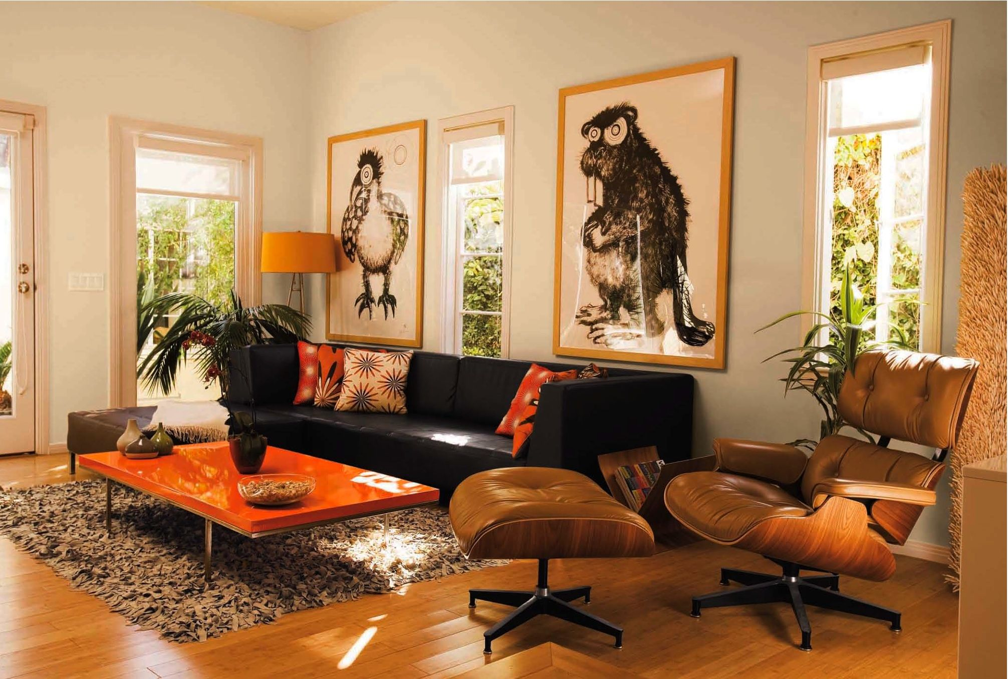 dark brown couch, orange accents, side chair and ottaman, lamp and