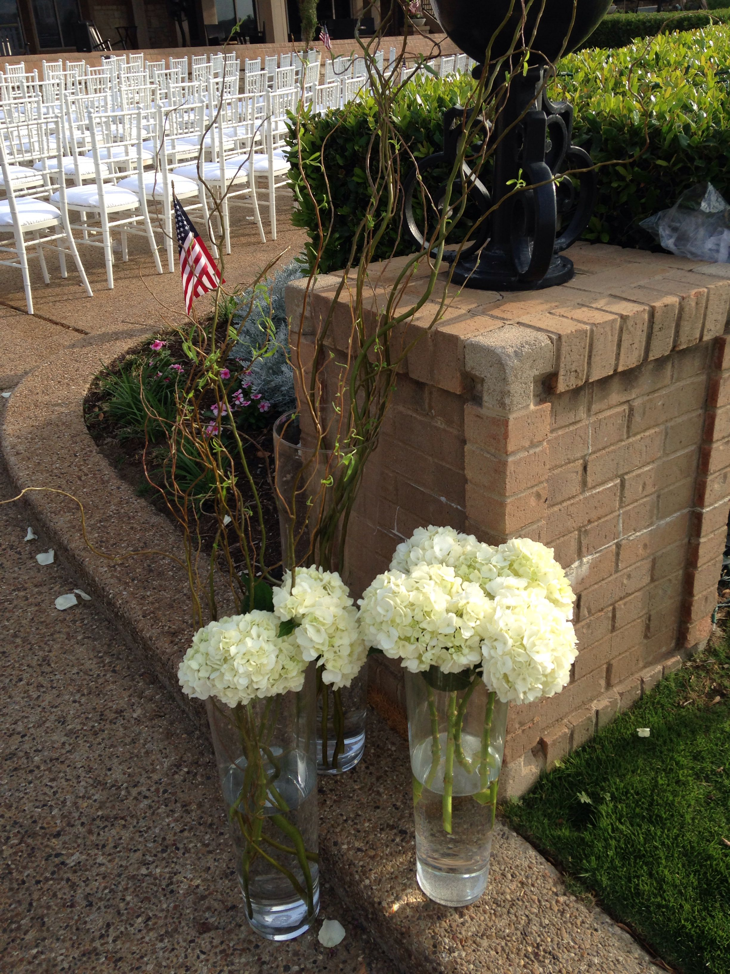 Entrance to ceremony with American flags for our veteran Groom.
