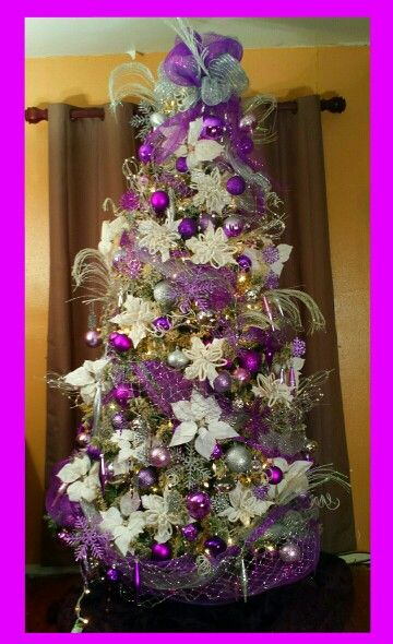 Purple And Silver Ornaments On A Flocked Christmas Tree Purple Christmas Tree Silver Christmas Tree Decorations Christmas Tree Decorations