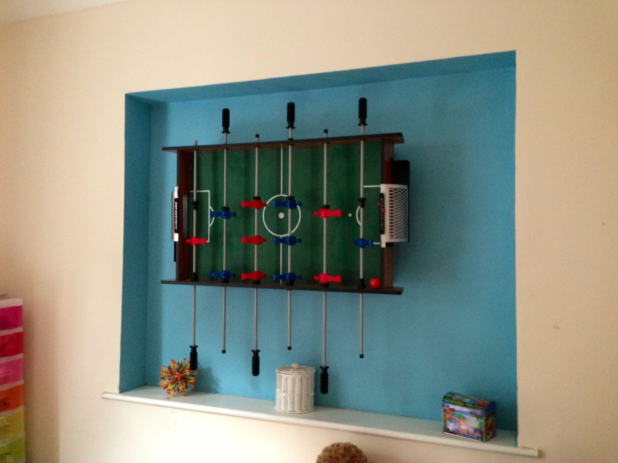 One way to store the football table in the playroom! It's now a feature wall too!