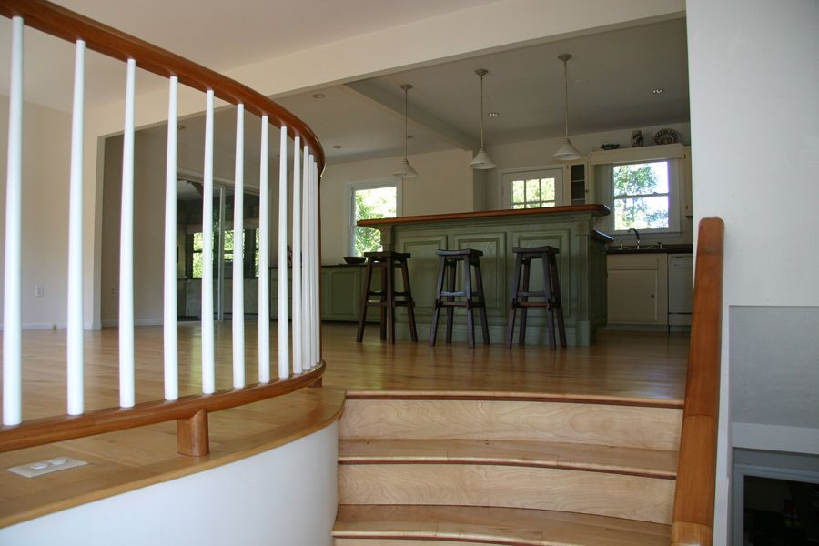 Additions to split foyer homes removed walls and built for House plans with stairs in foyer
