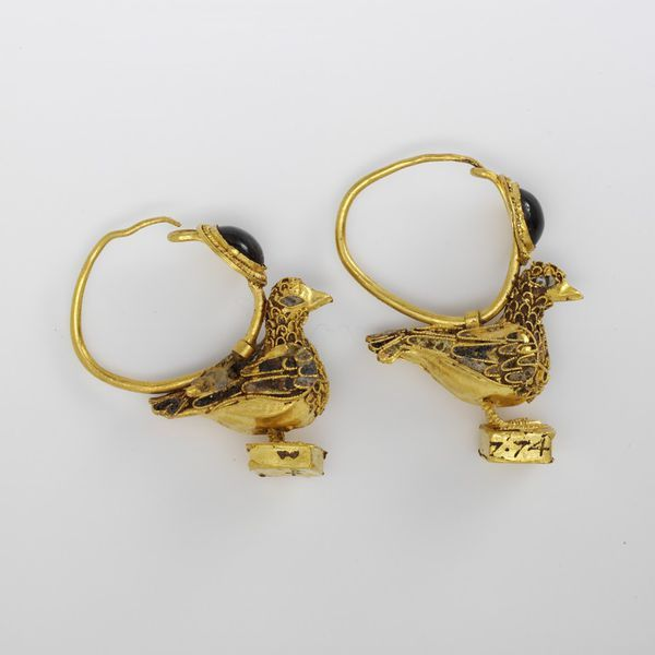 Earrings.  Place of origin: Greece (made).  Date: 200 BC-100 BC (made).  Artist/Maker: Unknown (production).  Materials and Techniques: Gold, with filigree, enamel and garnet.
