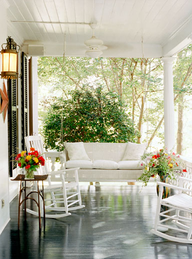 Rocking chairs and porch swing...freshly painted and gray floor...beautiful flowers...I would love to live here!