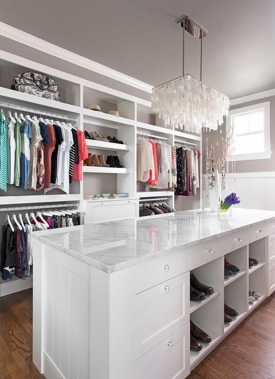 Chic Walk In Closet Features A West Elm Large Rectangle Hanging Capiz  Chandelier Placed Over A White Closet Island Fitted With Modular Shoe  Shelves Topped ...