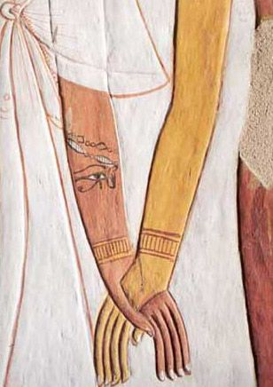 Hathor Holding Nefertari's Hand. This detail is at the northern face of the northwest pillar of the sarcophagus room at Nefertari's tomb, Egypt