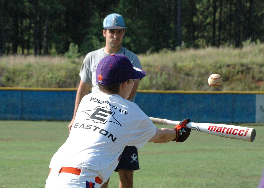 A Youngster Bunts A Ball Pitched By Jessie Cartner Of The Carolina Chaos Baseball Team During Hitting Practice At B Baseball Camp Baseball League Baseball Team