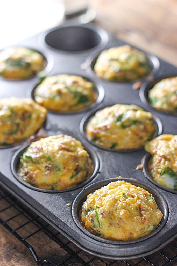 Breakfast Muffins On-The-Go Breakfast Muffins - A quick and easy way to get your eggs to go. Loaded with bacon bits, cheddar cheese and spinach!On-The-Go Breakfast Muffins - A quick and easy way to get your eggs to go. Loaded with bacon bits, cheddar cheese and spinach!