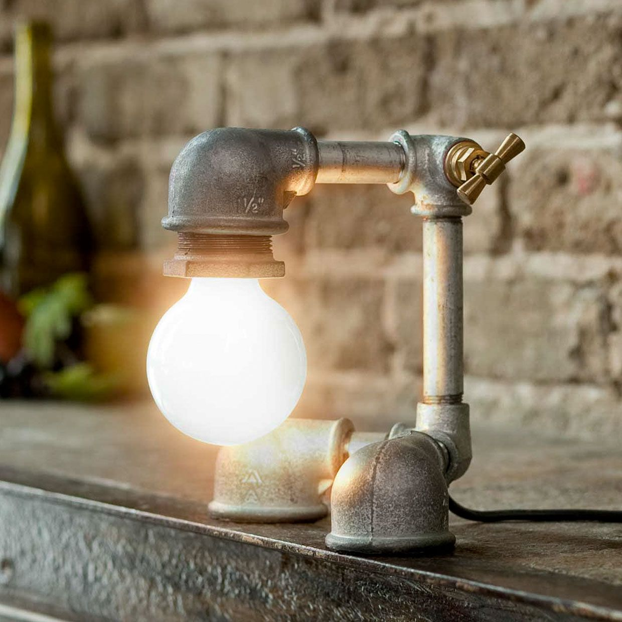 Incredible lamps made from old taps which use them as switches ...