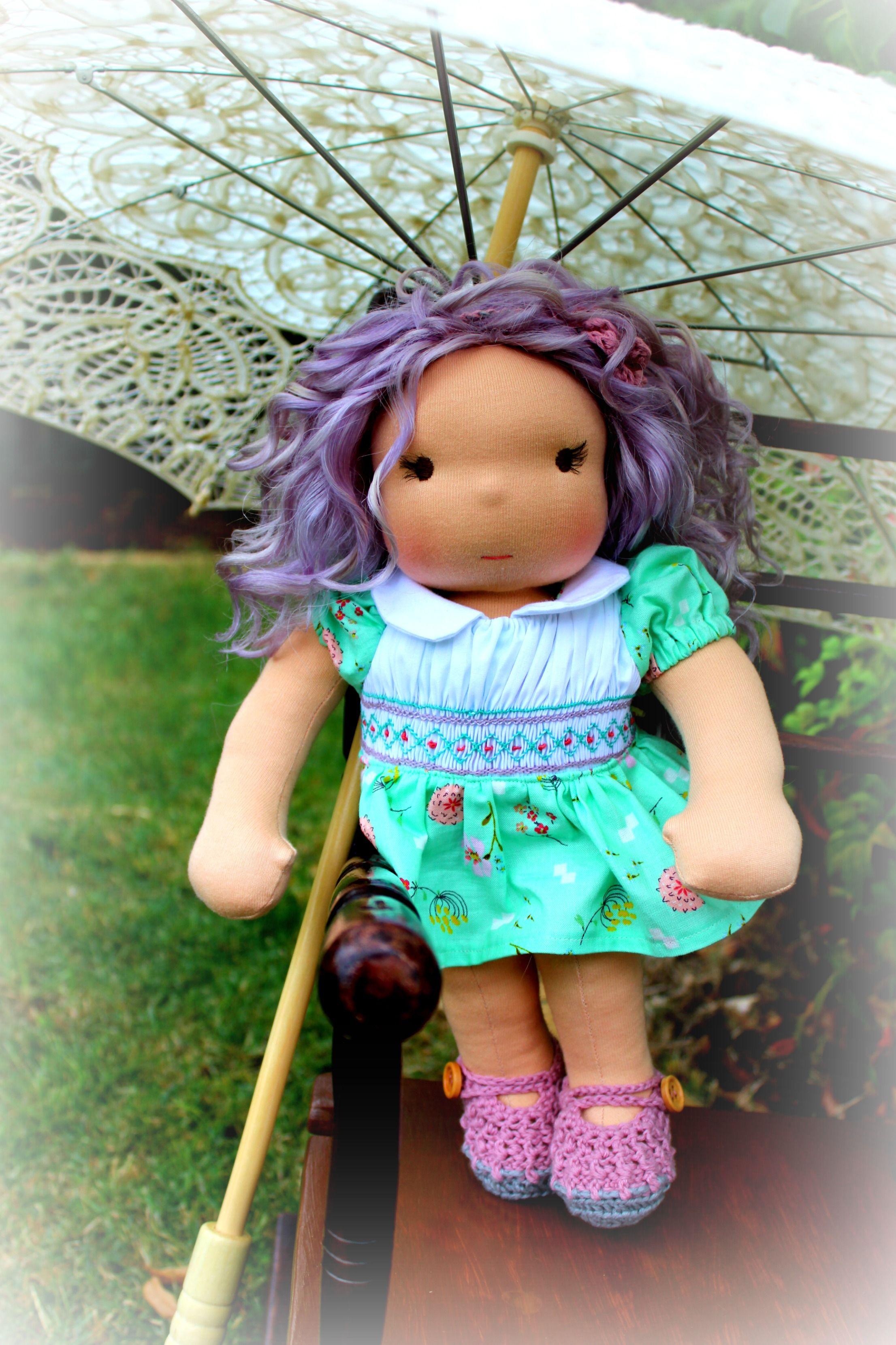 Pretty Arabella with her lilac curly hair.