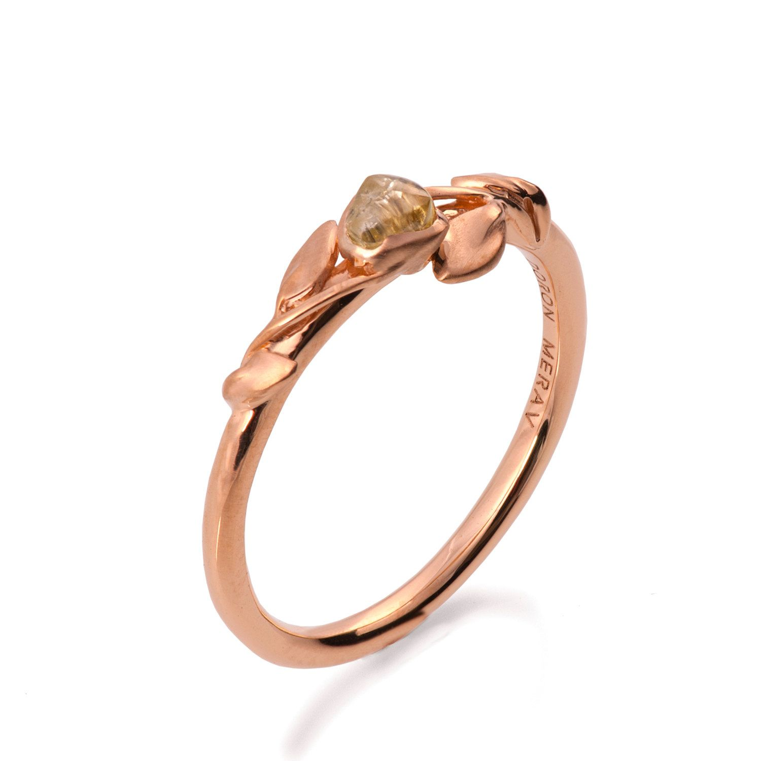 A handmade 18k rose gold ring set with a beautiful raw uncut