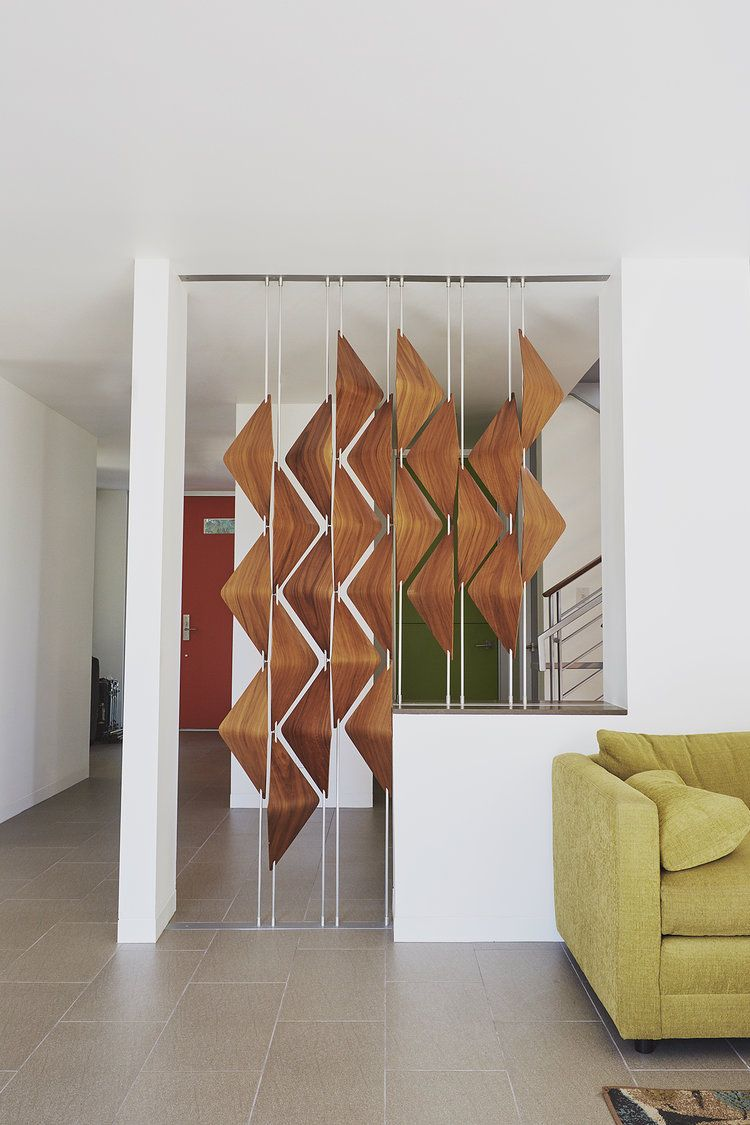 Modern room dividers the walnut window shades act as a for Living room partition