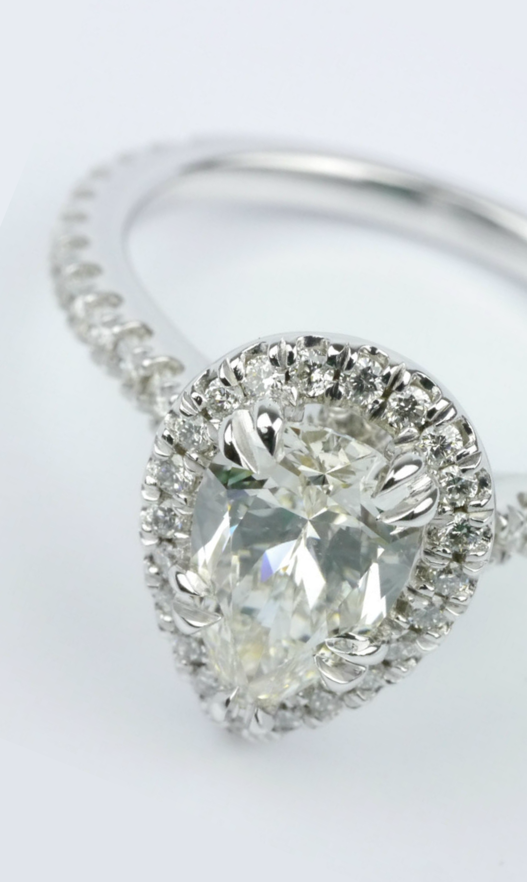 Petite halo pear diamond engagement ring wedding trends of