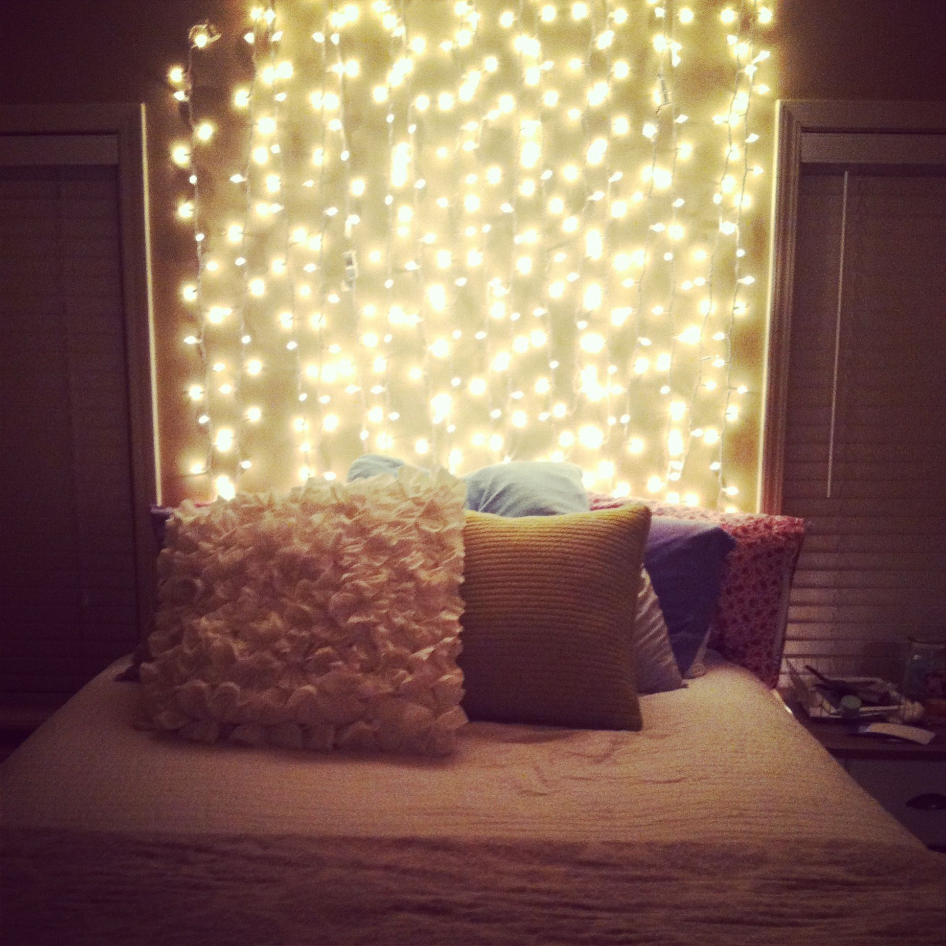 Strung lights up and down on my wall behind my bed. Super cheap and ...