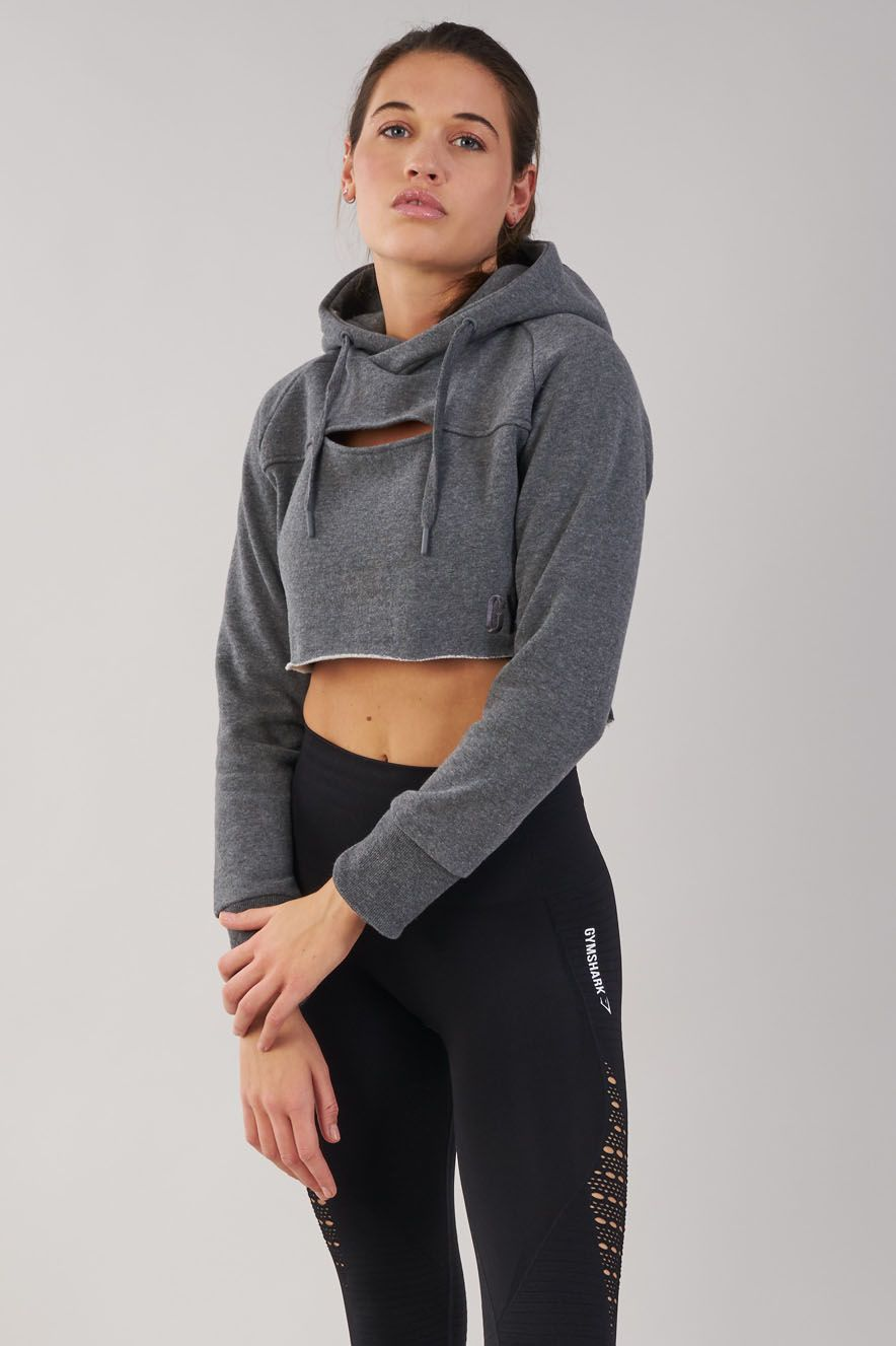 03e1051e Dominate your workout in effortless style with the Women's Cropped Raw Edge  Hoodie. Now available in Charcoal Marl.