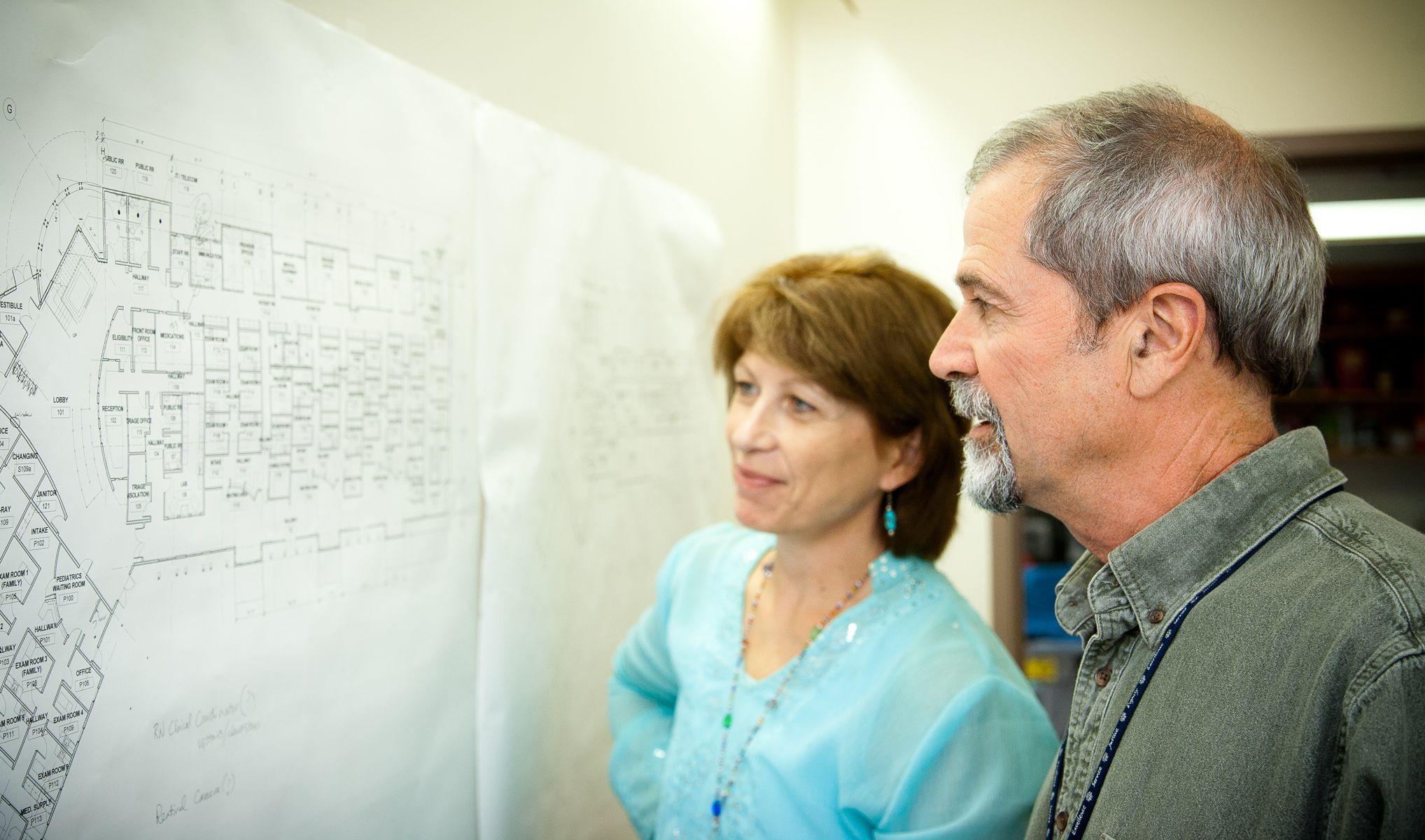 Looking Over The Plans For The New Eureka Community Health Center Eureka California Health Center Health Couple Photos