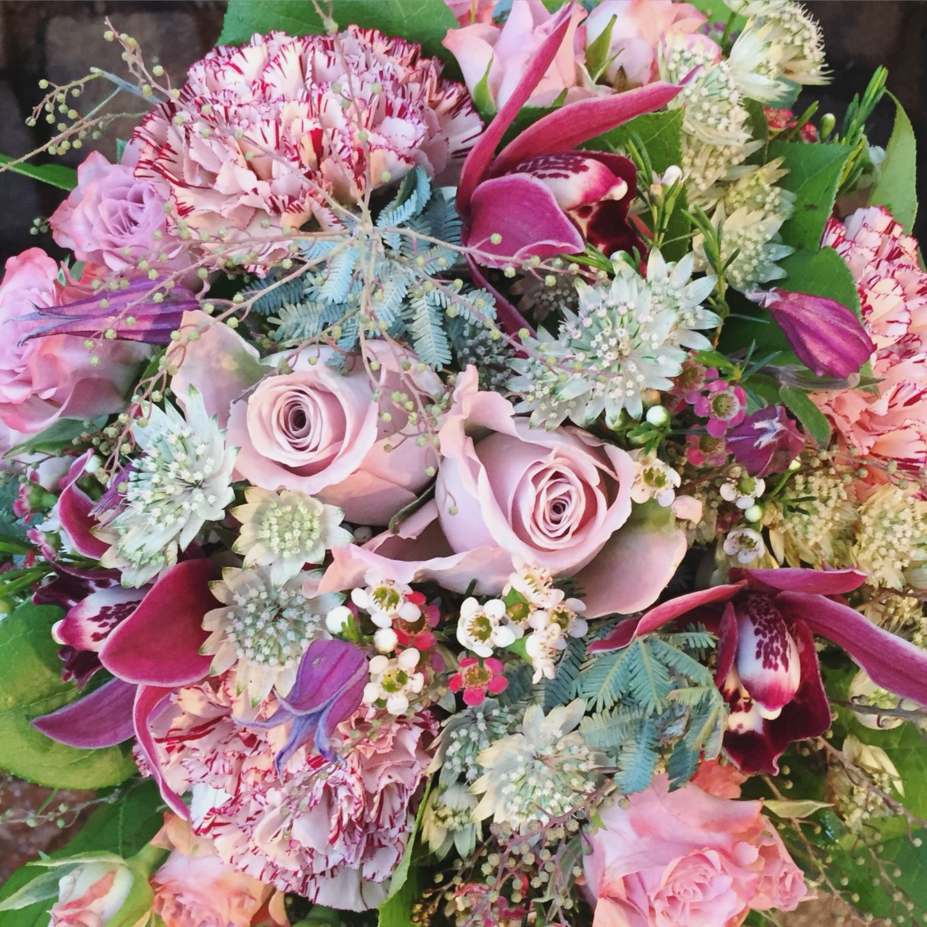 Pale Bouquet Using Roses Orchids Carnations Acacia Astrantia And Wax Flower Wax Flowers Orchids Astrantia