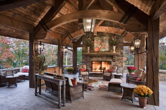 Backyard Heaven with Stone Fireplace, Arched Wood Beams and Surrounded by Woods