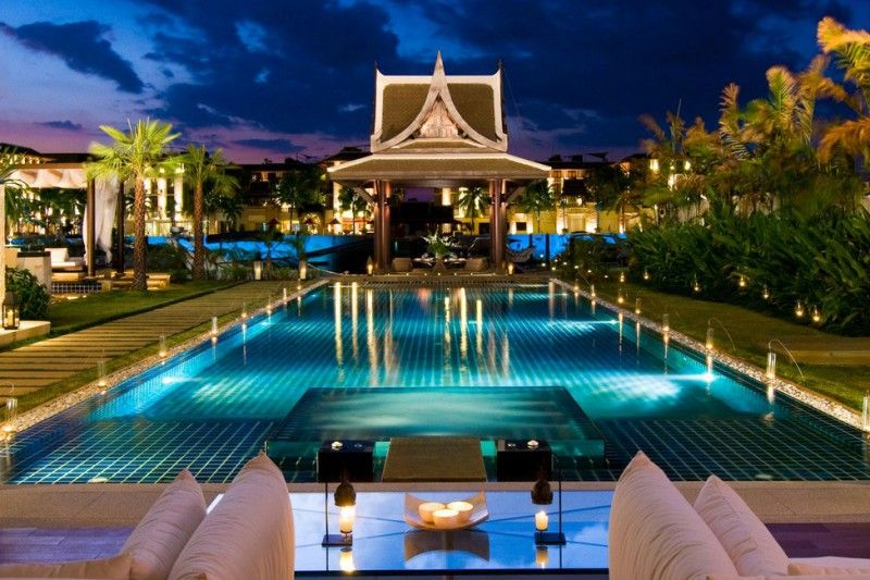 This villa with a private yacht berth is located in the Royal Phuket Marina, in Phuket, Thailand. It is a vibrant paradise of bright green palm trees and smooth flowing water, with an interior that exudes calm elegance.