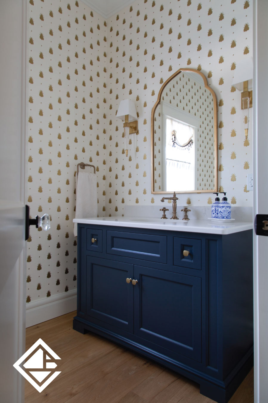 This navy blue custom vanity provides the perfect contrast