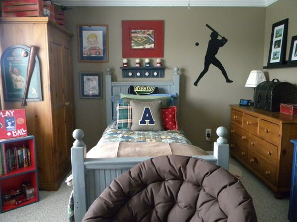 A Traditional Boyu0027s Bedroom With Cozy Interior And Sports Related  Decorations
