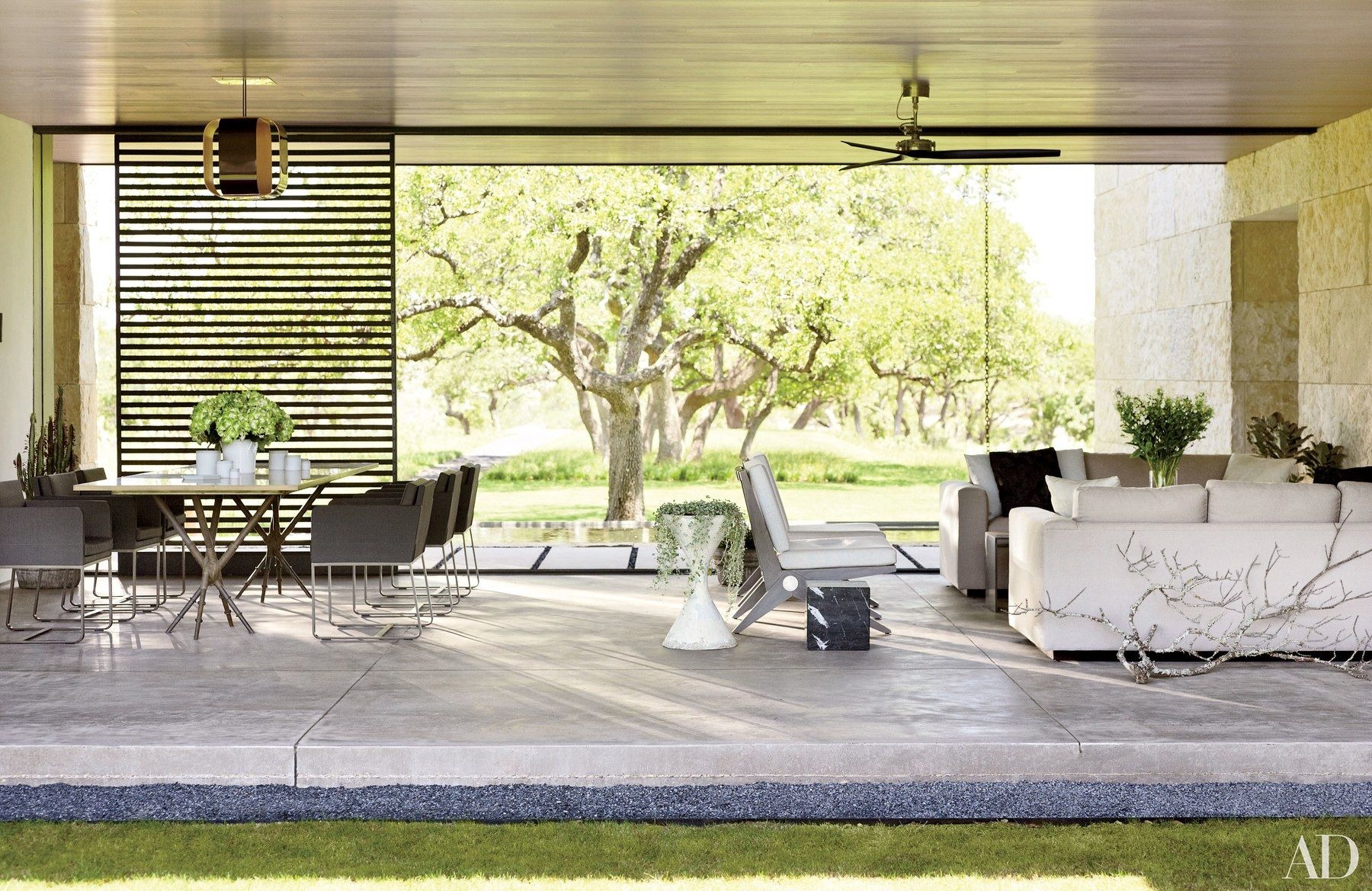 A loggia paved with sandblasted concrete links the main house to the ...