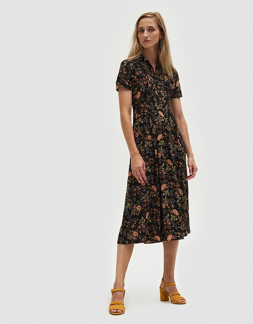 a926f1d10ad 90s-inspired dress from Farrow in Black. Allover floral print. Pointed  collar with tie details. Short sleeves. Straight back yoke with inverted  center box ...