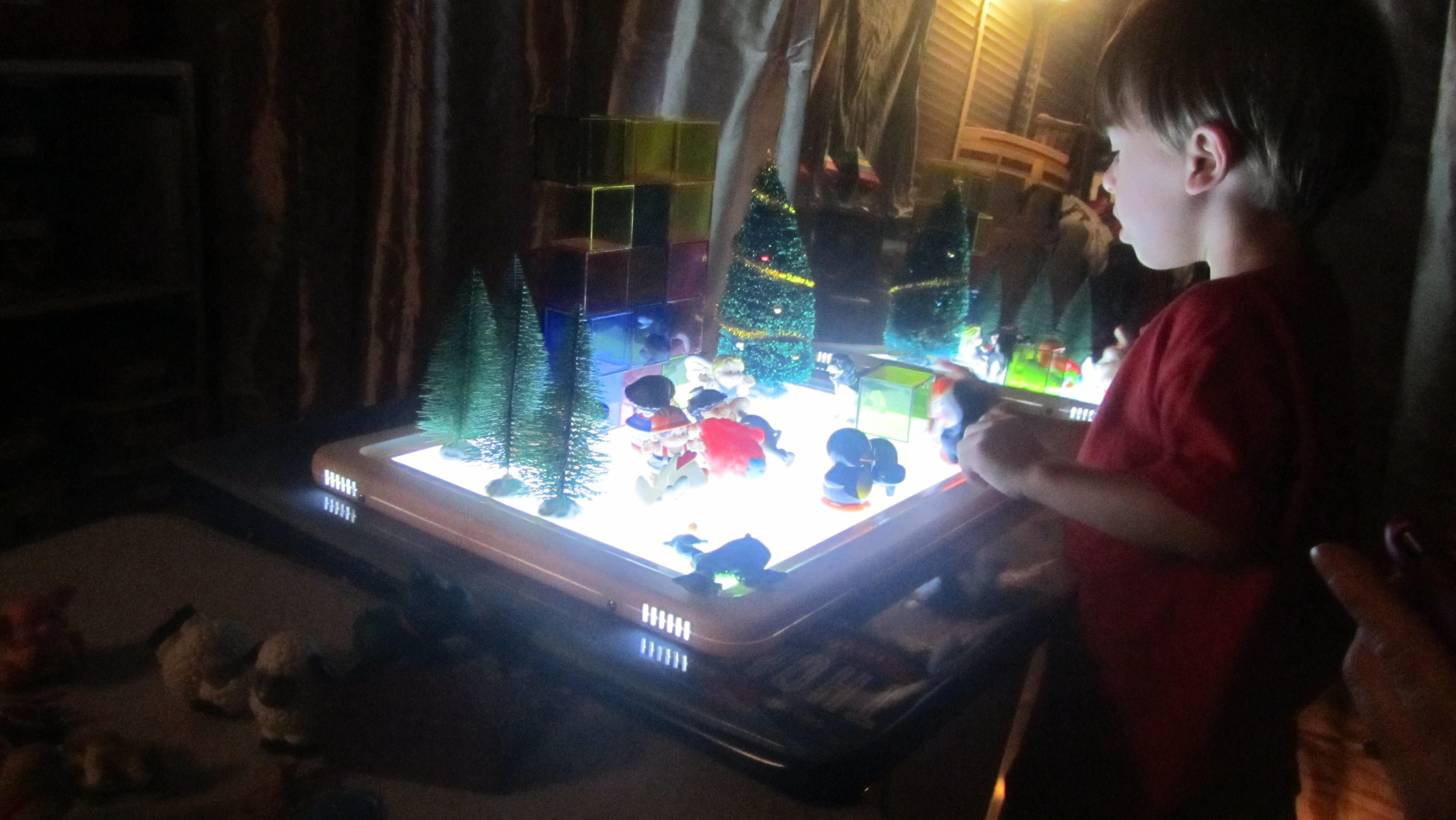 light table fun with crystal cubes, trees, little animals. and  people
