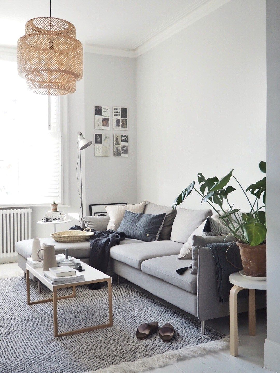 A Light Scandi Style Living Room With Painted White Floorboards And A Grey Co Small Space Living Room Scandinavian Design Living Room Living Room Scandinavian