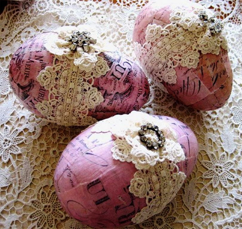 Easter eggs covered with lace bows