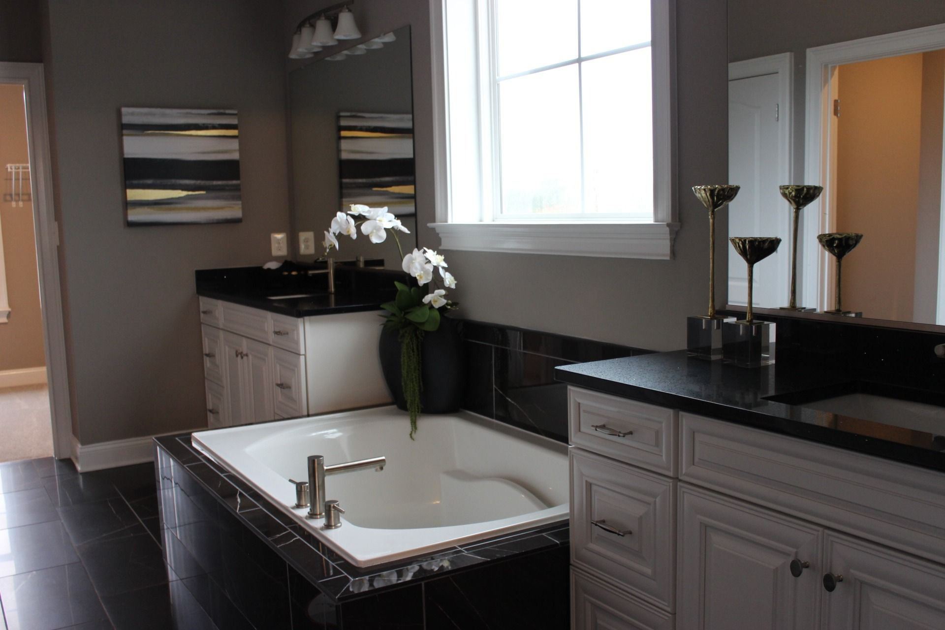Look At This Unique Bathroom That Incorporates Black Stone With