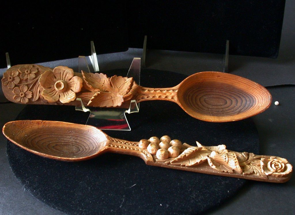 Vintage pair of wooden spoons with hand carved floral